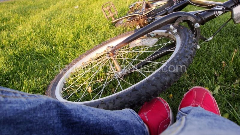 red shoes of person next to bike