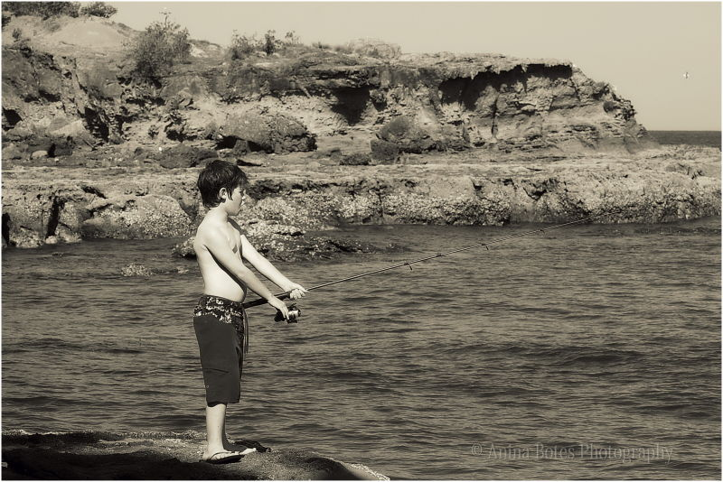 Boy, beach, rocks, fishing, sepia