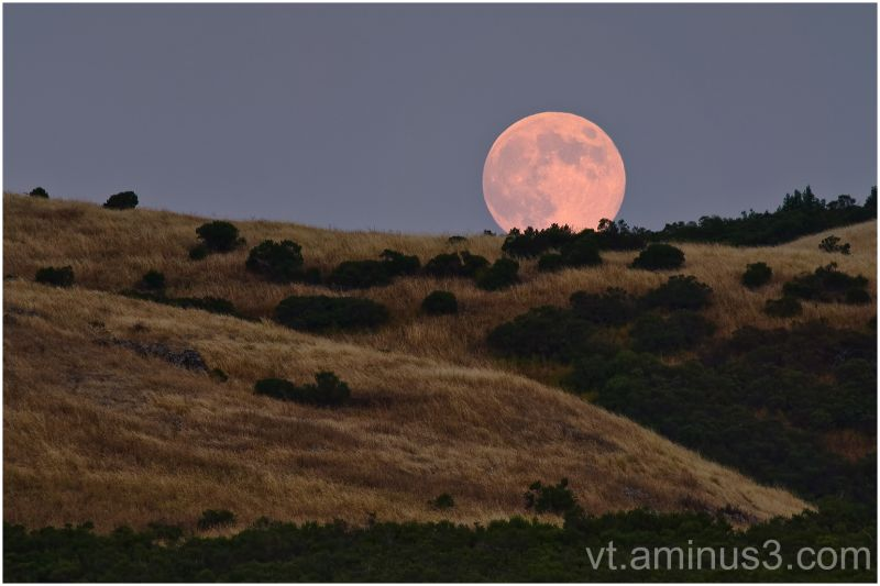 Full moon rising over Santa Cruz Mountains, CA