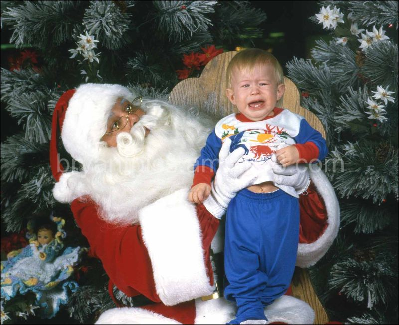 Santa acts scared of crying boy
