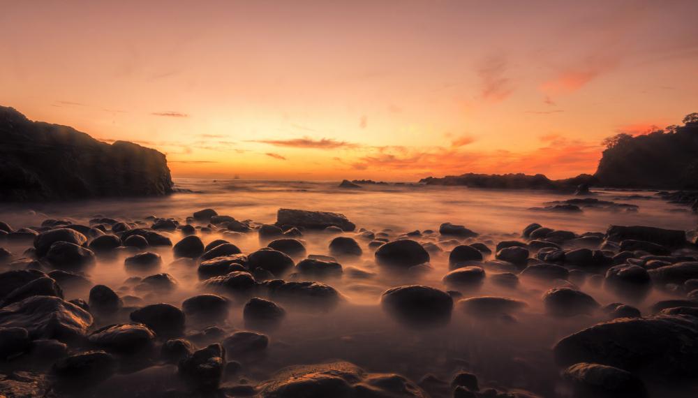 costa rica ocean water at sunset long exposure