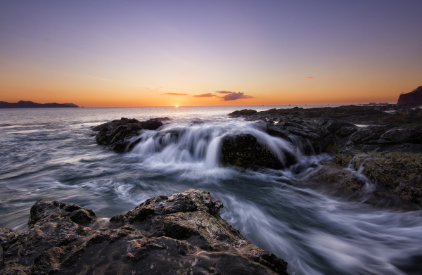 long exposure ocean tide at sunset in costa rica