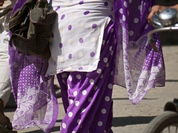 She wore an [ibtw] purple polkadot.....salwar suit