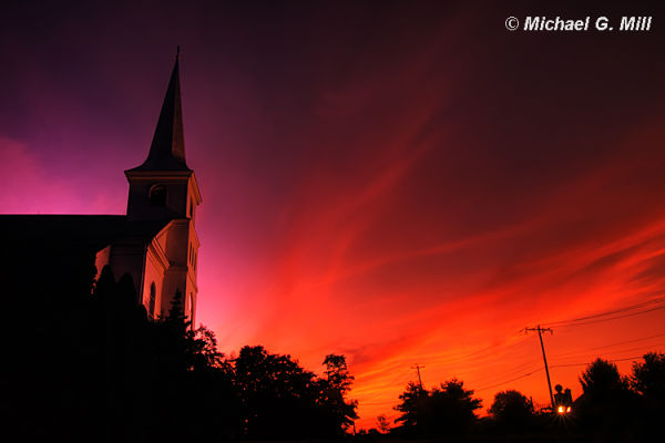 Church silhouetted against a beautiful sunset.