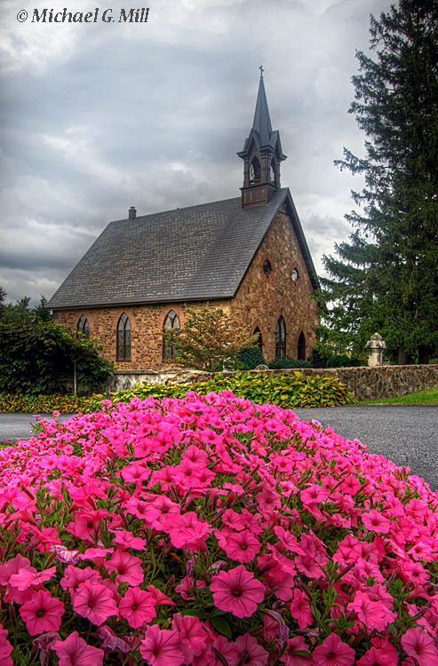 Storm clouds over an old stone church.