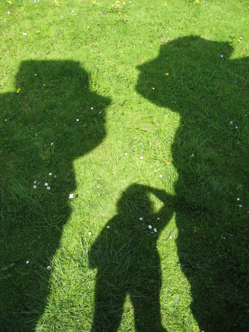 faces and me lying on the grass