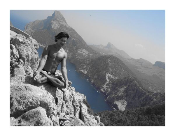 Yoga on a cliff in Mallorca Spain