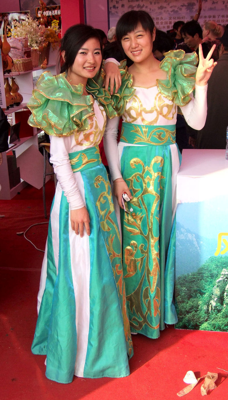 Two girls pose at a Trade Show