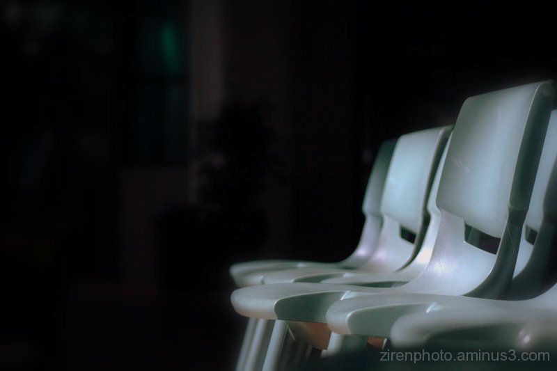 Lit chairs under the spotlight.