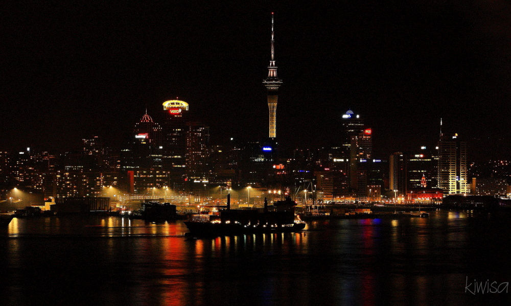 Ship sailing out of Auckland harbour at night