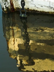 The bow of a sunken boat