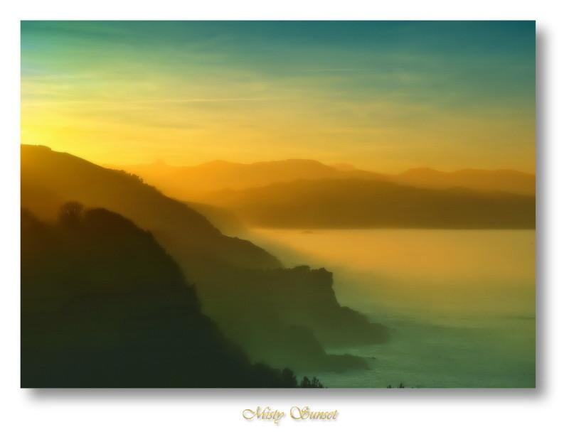 Misty Sunset near Donostia. Basque Country, Spain.