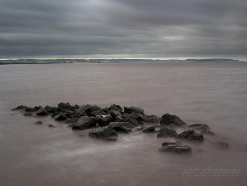 Rocks emerging from a choppy high tide
