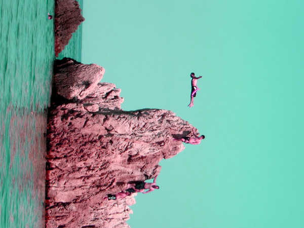 the man diving in to green