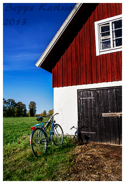 Bike next to barn in Sweden