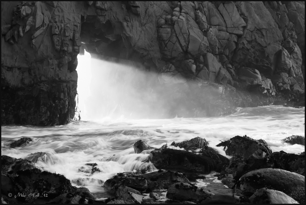 Arch at Pfeiffer Beach with shaft of light