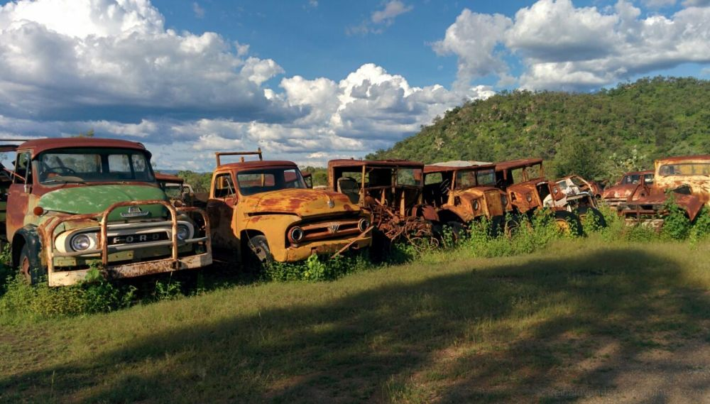 rusty old vehicles abandoned