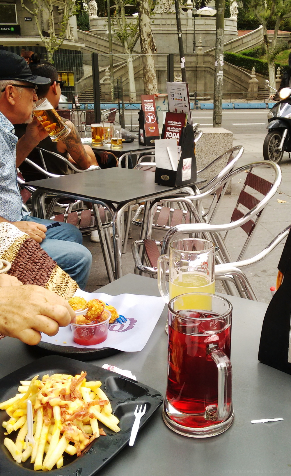 Enjoying a drink on the street