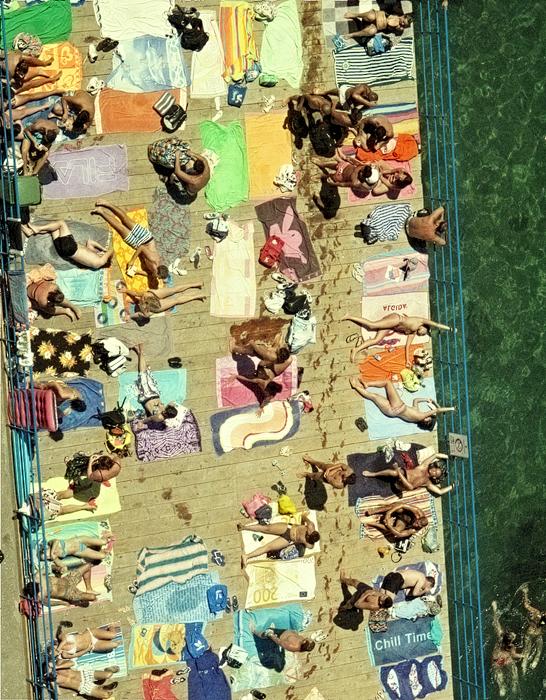 sunworshipers on the boardwalk in Sorento Italy