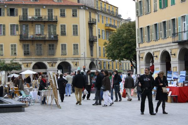 Artists selling paintings on square in Nice