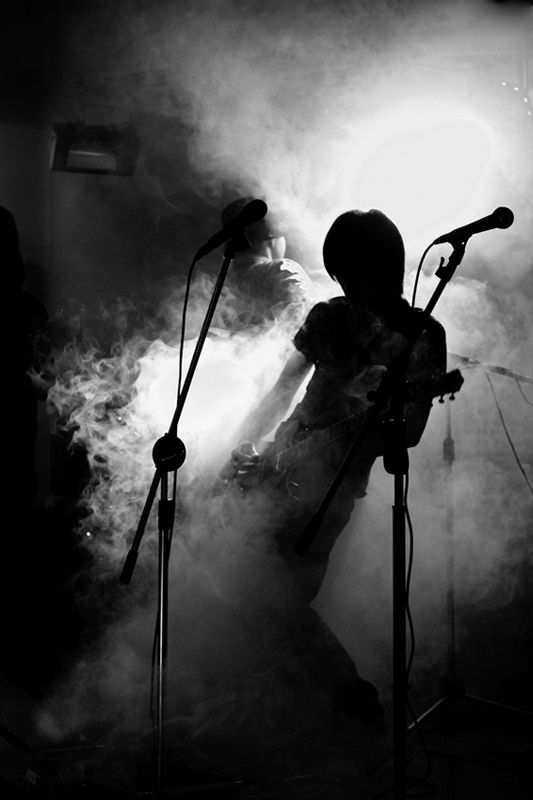 Guitar player in the smog
