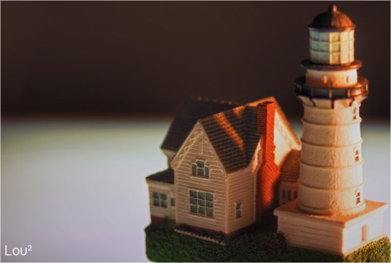 A close up on a lighthouse miniature