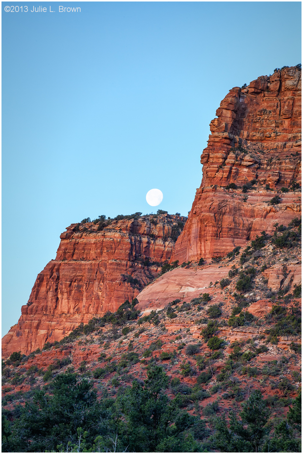 moon over red rock at sunrise sedona arizona