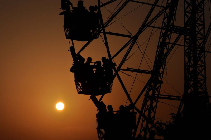 people in a giantwheel at sunset