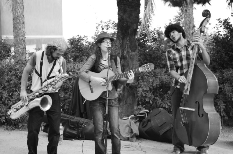 Trio playing in a park in Barcelona
