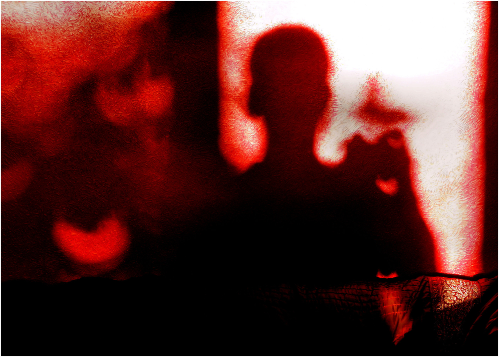 Ombre sur un mur rouge