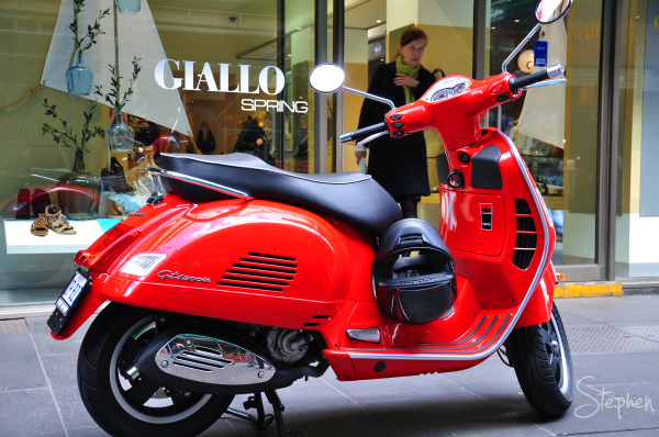 Vespa scooter on Collins Street in Melbourne