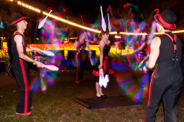 Cirquaholics juggling LED light pins at NightFest