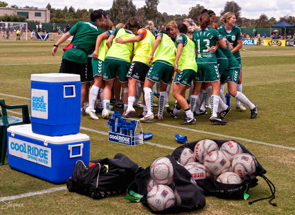 Canberra United players break from the team huddle