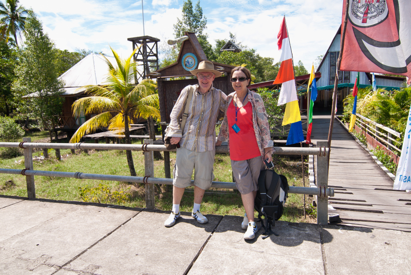 Maureen and I are exploring the town of Agats in the Asmat region of Papua. A local man named Dave kindly offered to take our photo in front of a church.