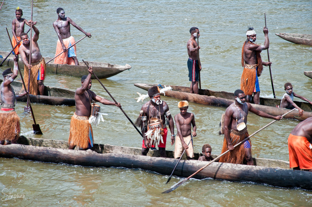 War canoes greet the Orion in the Asmat