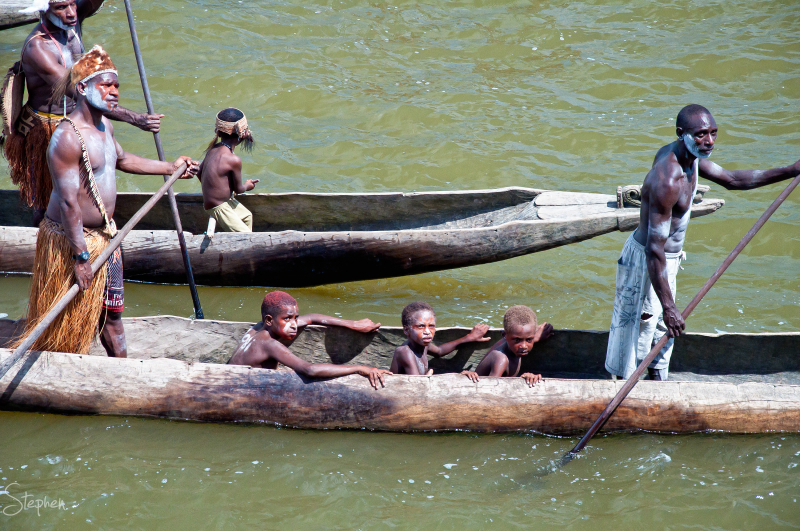 [i]Asmat war canoes greet our arrival on the river off Syuru Village. We could hear the war cries of the Asmat warriors while they still had their boats hidden in the mangroves waiting to &lsquo;ambush&rsquo; us. There were over 60 canoes.[/i] 
