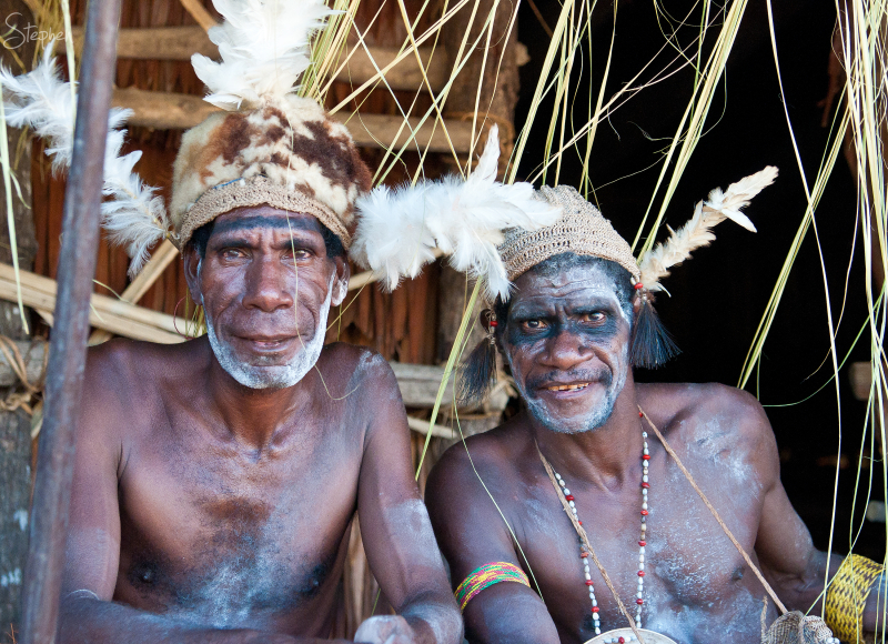 A portrait of two Asmat tribal elders. I met them outside the Men&rsquo;s House in Syuru village.