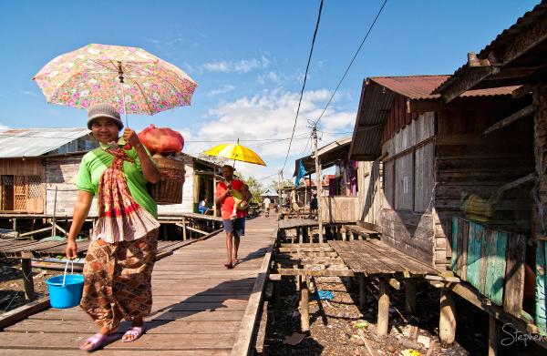 To market along the boardwalk in Agats in Asmat
