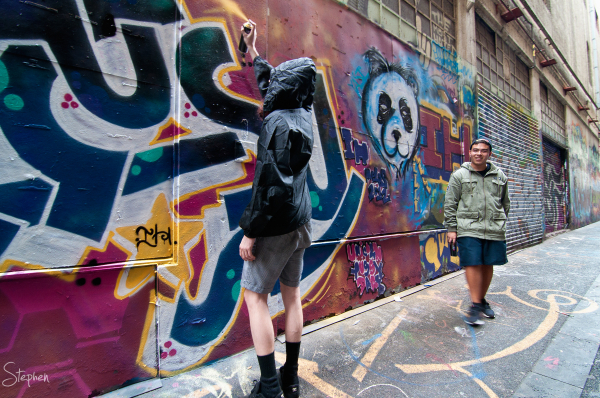 Street artists at work in Union Lane Melbourne