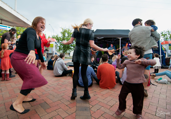 Dancing in street at Lyneham Party at the Shops