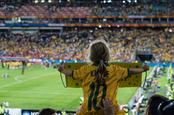Young Socceroo fan with banner at Asian Cup Final.