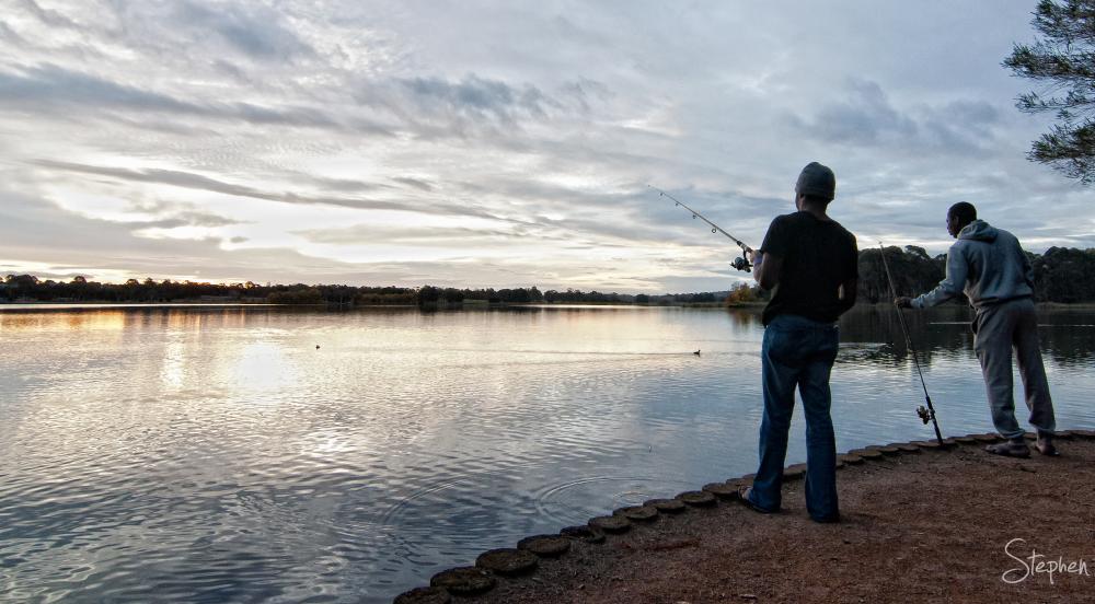 Fishing on the shore of Lake Ginninderra