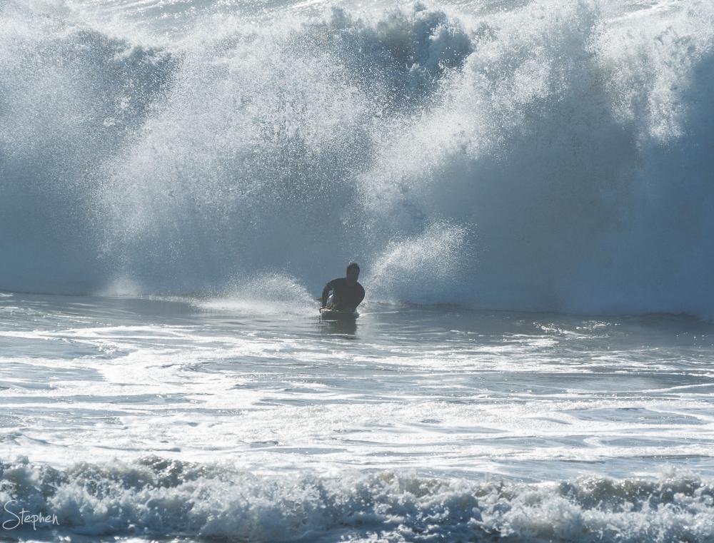 Riding big storm waves at Dalmeny main beach