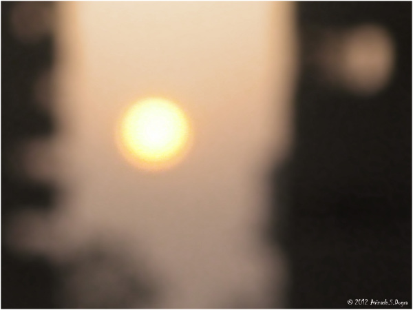 Sunset with a blurred eye