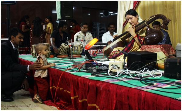 Lil' Yuvan enjoying a Veena concert...