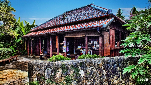 An old style Okinawa house and stone fence.