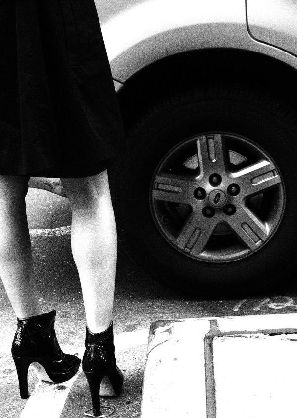 quaffed woman awaits taxi