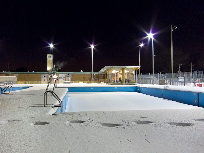 """High Park"" Toronto Winter snow pool night lights"