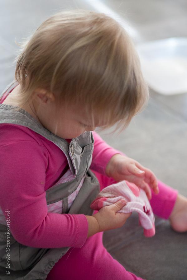 Little girl pulls her socks off