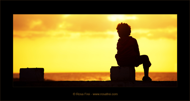 Silhouette of a boy at sunset